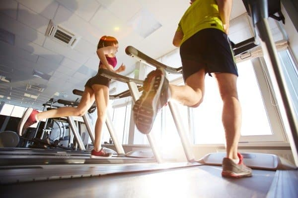 man and woman doing a treadmill workout