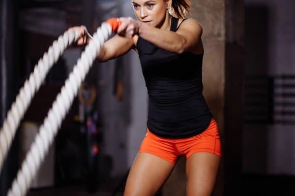 woman doing heavy rope training