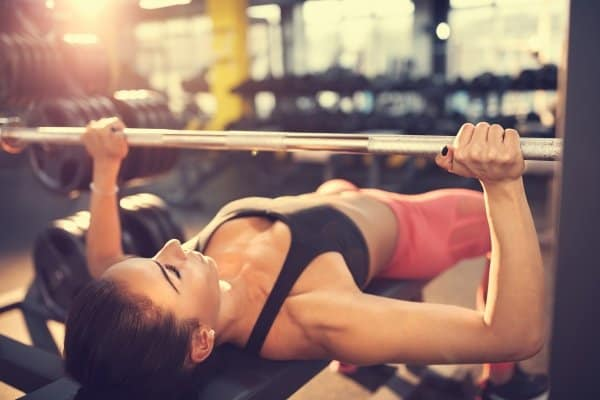 young woman bench press