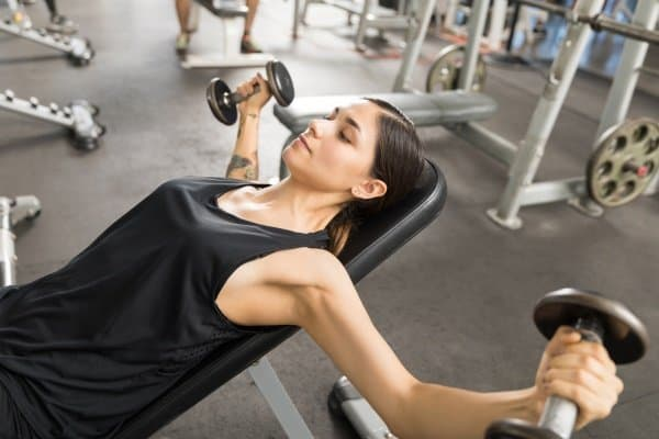 woman doing incline dumbbell fly