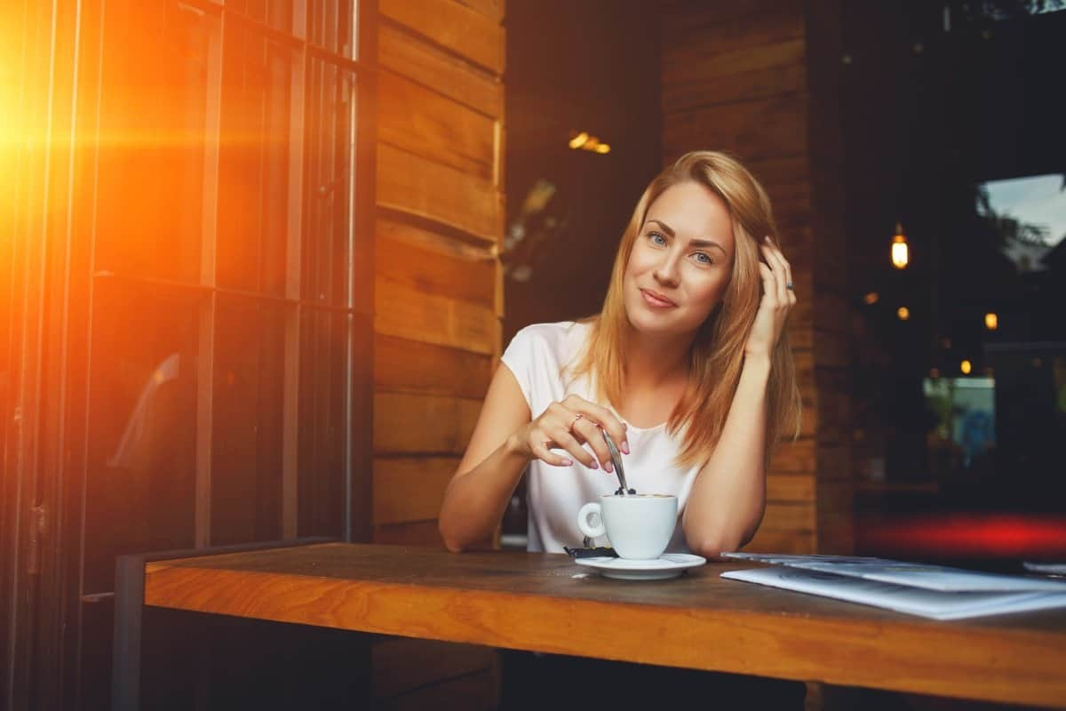 woman in cafe drinking coffee in the morning