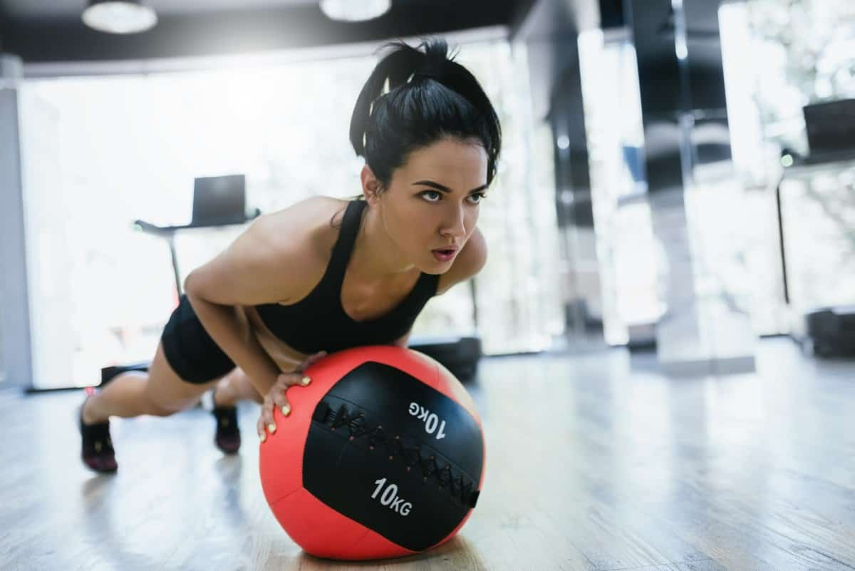attractive woman doing push-ups in gym