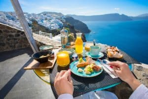 woman eating a high carb meal in Greece