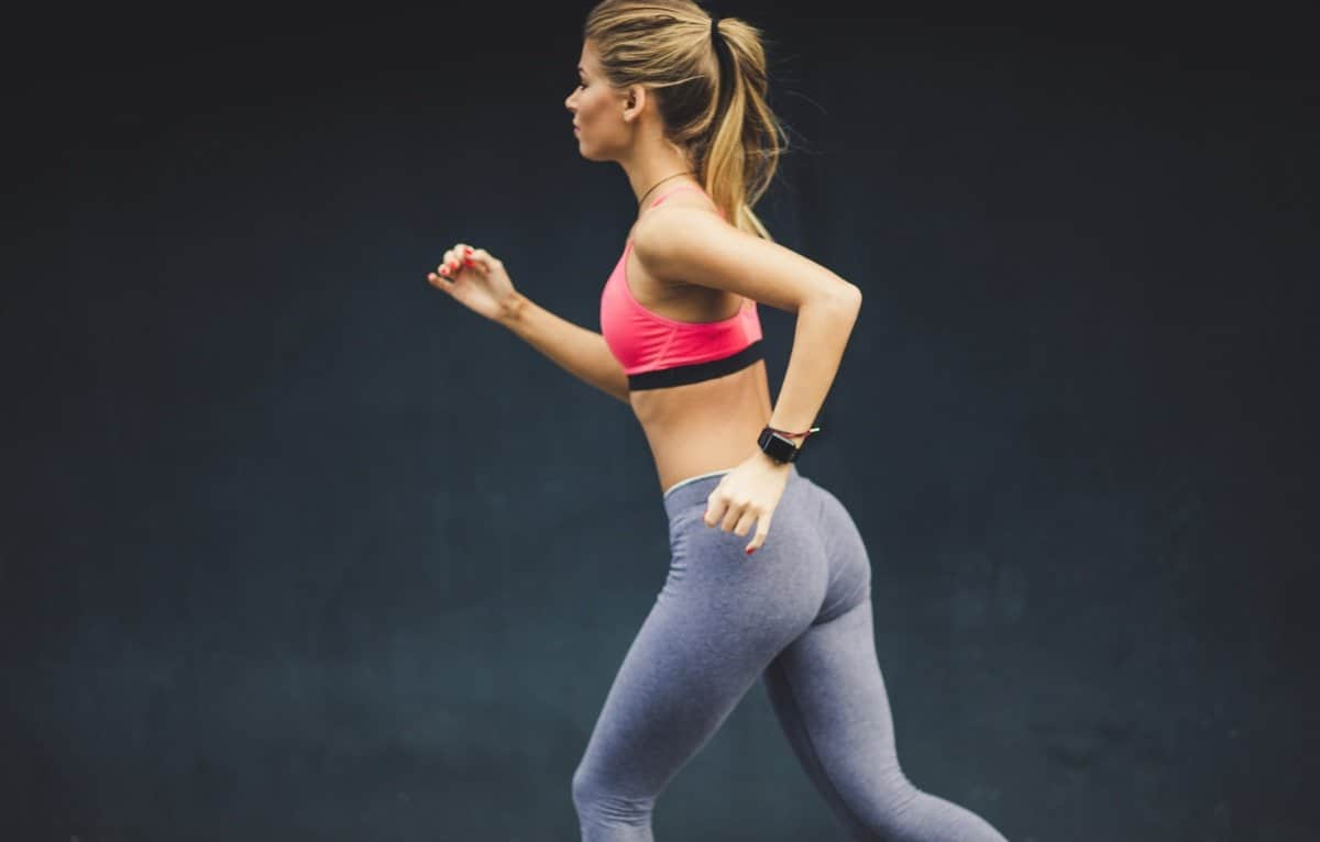 healthy young woman running for fat loss