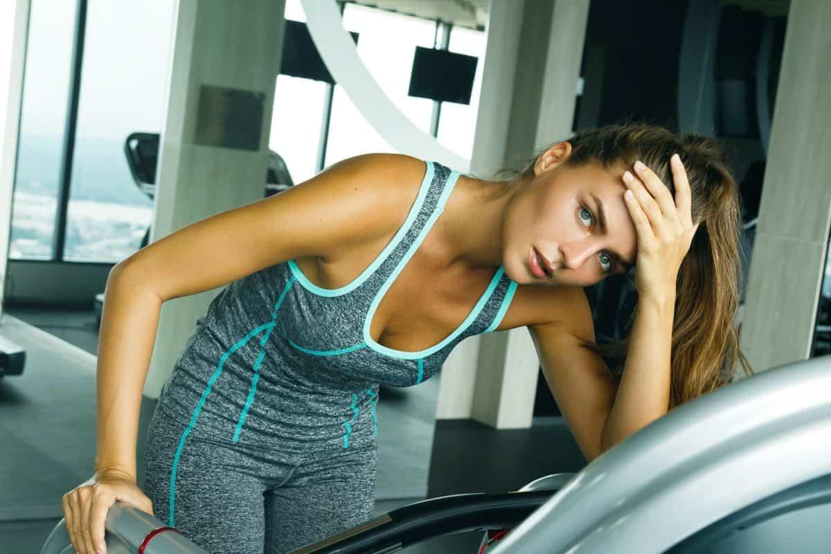 woman resting on treadmill