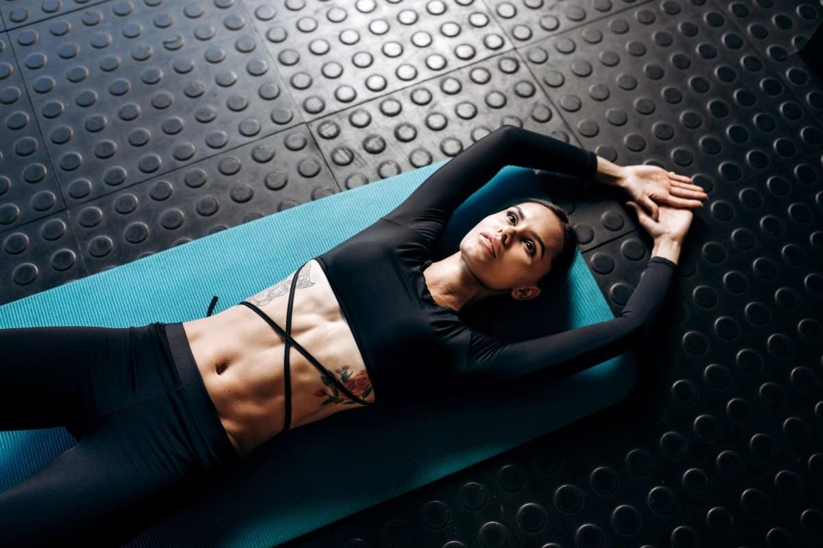 woman with toned abs laying on the floor