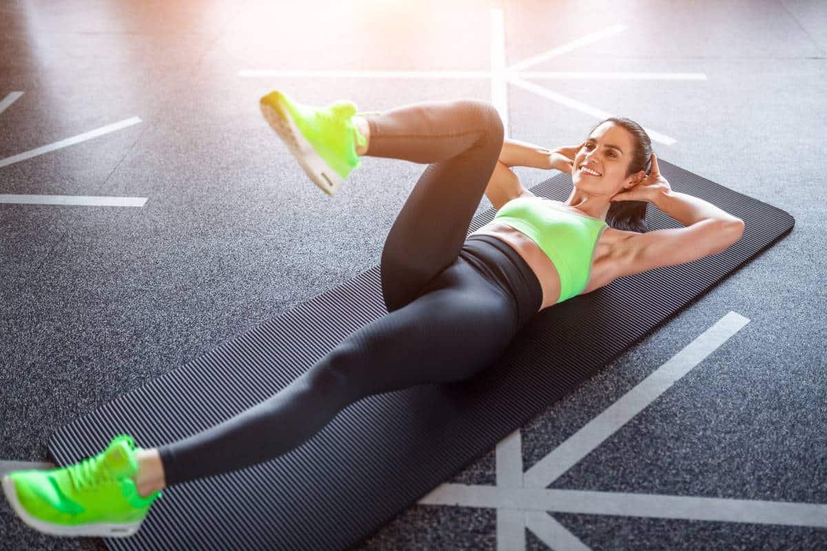 woman doing intense ab workout on floor
