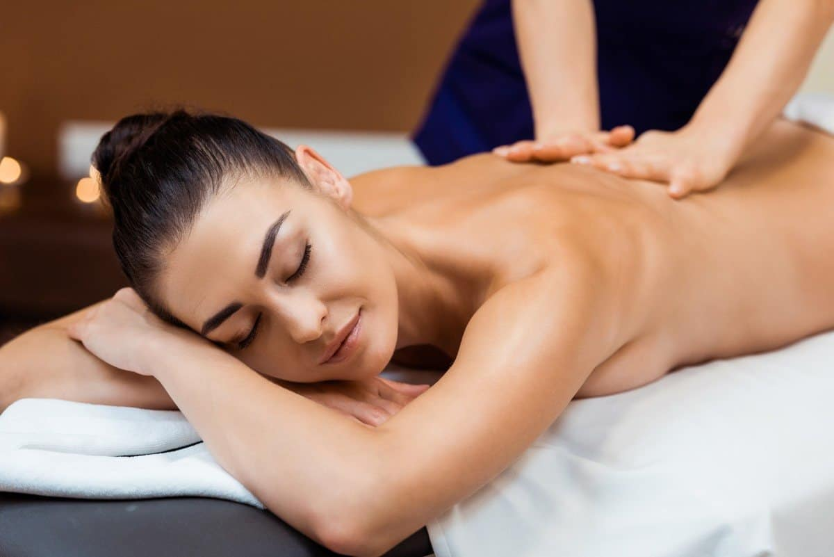 attractive woman getting a massage on massage table