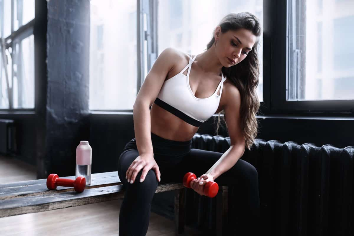 woman lifting weights to increase HGH