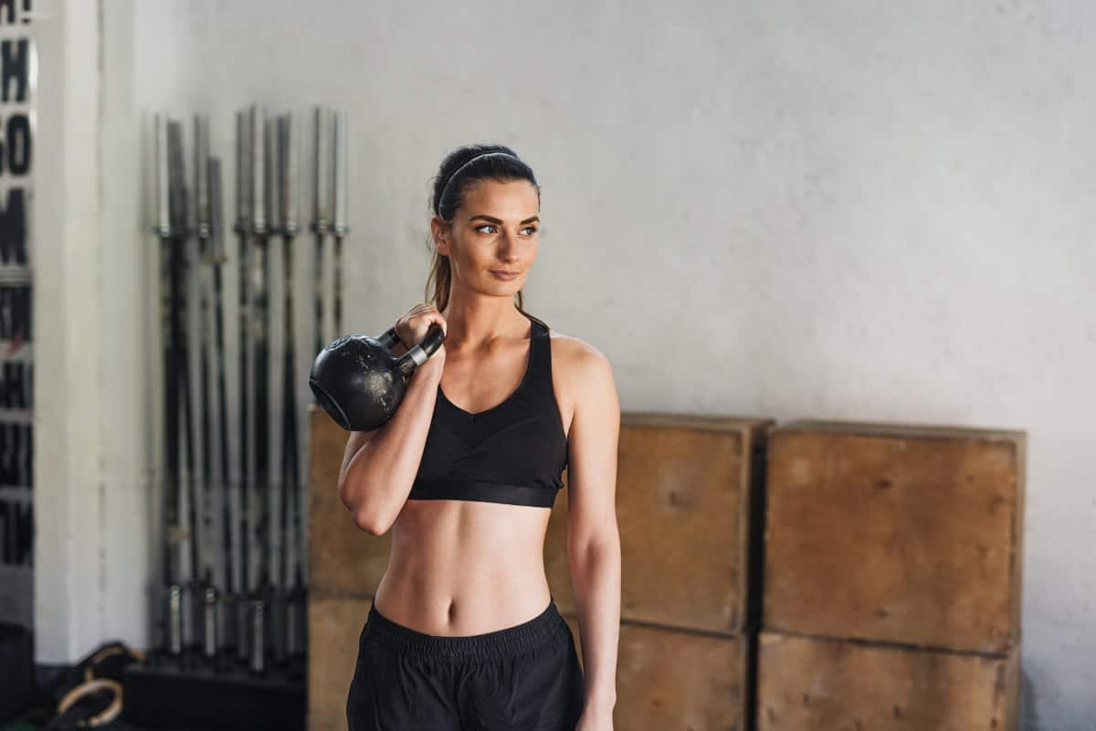 attractive woman holding a kettlebell