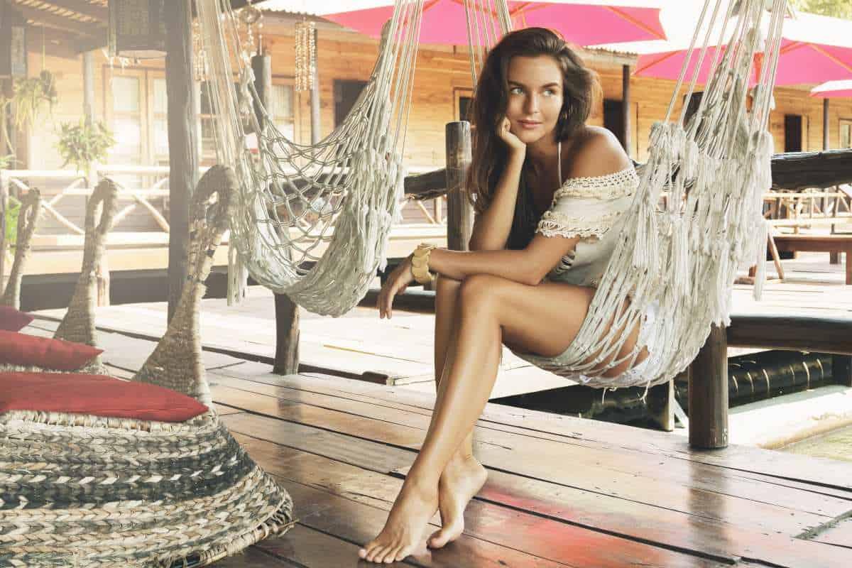 pretty woman sitting in hammock